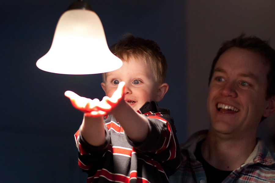 colorado-toddler-looks-at-lit-hands